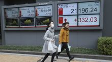 Asian shares mostly higher on US-China trade deal optimism