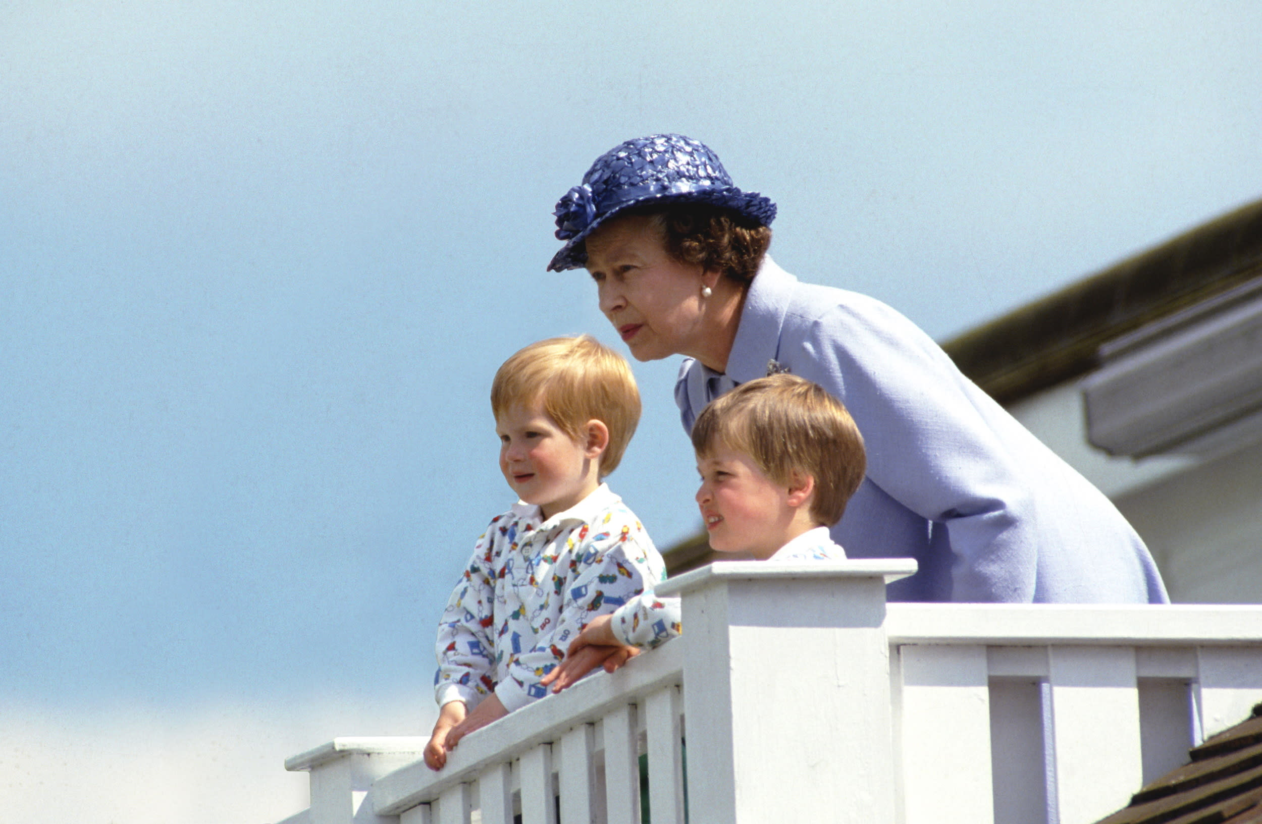 UNITED KINGDOM - JUNE 14:  The Queen With Prince William And Prince Harry In The Royal Box At Guards Polo Club, Smiths Lawn, Windsor  (Photo by Tim Graham/Getty Images)