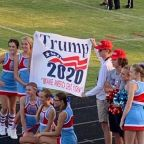 High school cheerleaders 'on probation' after posing with Trump banner during football game