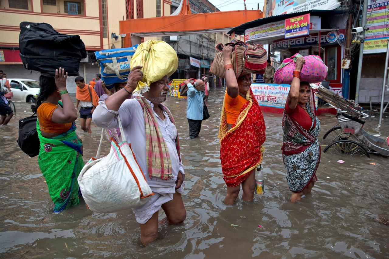 <p>Indian floods wreak havoc</p><p>Indian devotees carry their luggage and wade through the flooded water in Varanasi, India, Friday, Aug. 26, 2016. (AP Photo/Tsering Topgyal)</p>