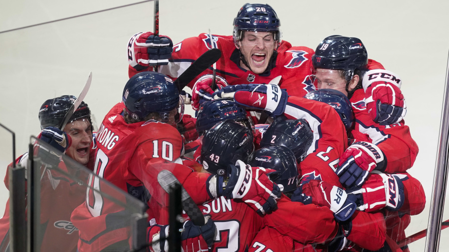 Caps squeeze one past Bruins for OT win
