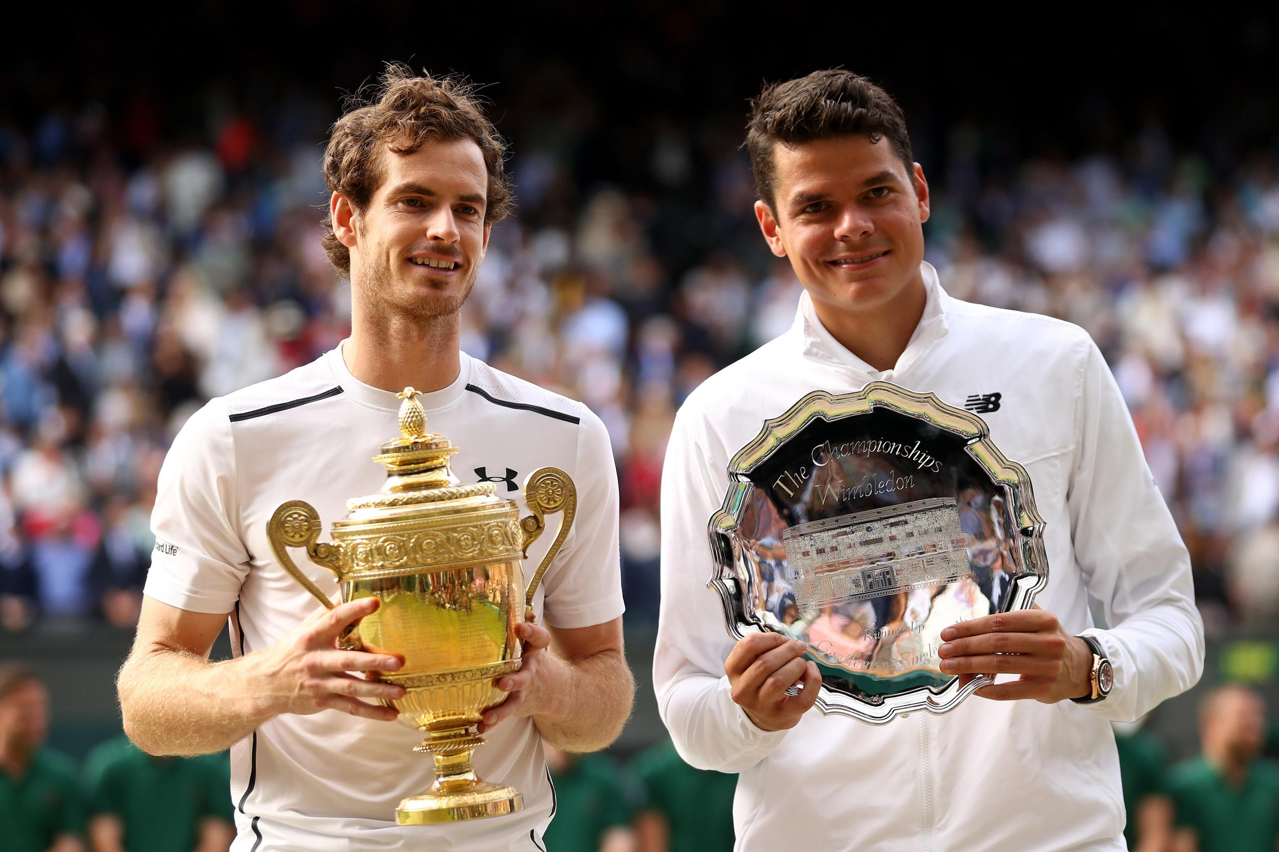 Andy Murray and Milos Raonic hold their trophies.