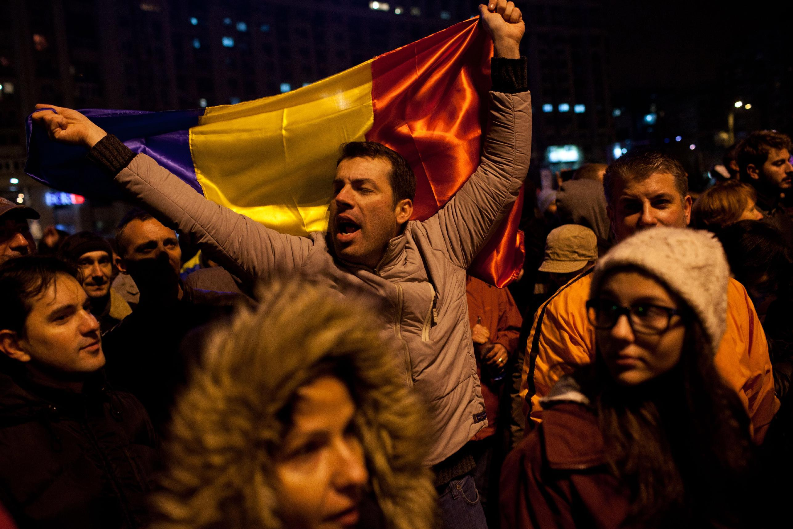 A man shouts a slogan during a protest against Romanian prime minister and presidential candidate Victor Ponta on November 14, 2014, in Bucharest