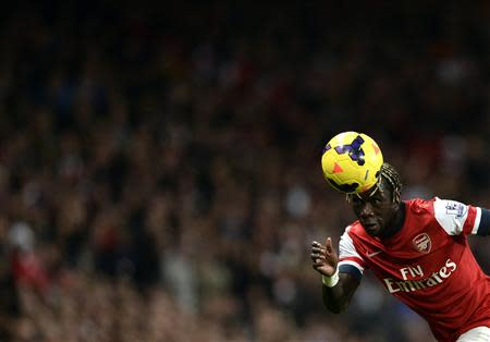Arsenal's Sagna heads the ball during their English Premier League soccer match against Liverpool at the Emirates stadium in London