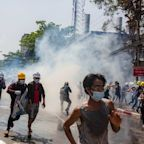 Myanmar police clash with protesters, at least 18 dead