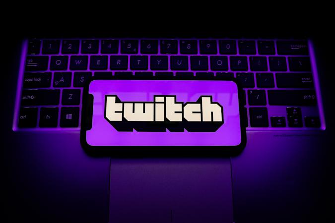 Twitch logo is seen displayed on a phone screen in this illustration photo taken in Krakow, Poland on April 30, 2021. (Photo by Jakub Porzycki/NurPhoto via Getty Images)