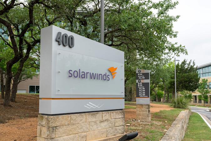 """The SolarWinds Corp. logo is seen on a sign at the headquarters in Austin, Texas on April 15, 2021 in Austin, Texas. - The United States announced sanctions against Russia  and the expulsion of 10 diplomats in retaliation for what Washington says is the Kremlin's US election interference, a massive cyber attack and other hostile activity. The White House said the sanctions likewise respond to """"malicious cyber activities against the United States and its allies and partners,"""" referring to the massive so-called SolarWinds hack of US government computer systems last year. (Photo by SUZANNE CORDEIRO / AFP) (Photo by SUZANNE CORDEIRO/AFP via Getty Images)"""