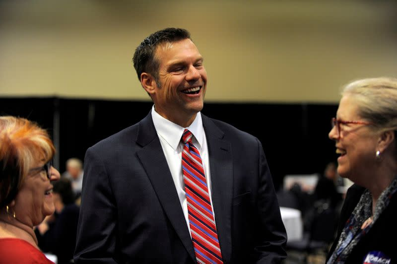FILE PHOTO: Republican gubernatorial candidate Kris Kobach greets supporters at his election night party in Topeka
