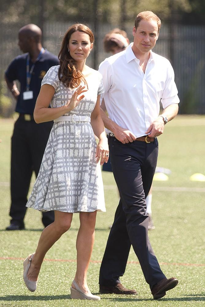 Kate and William visited Bacon's College with Prince Harry, Kate dressed in a grey and white checked dress.