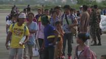 Thousands of Filipinos displaced by the typhoon arrive in Cebu island