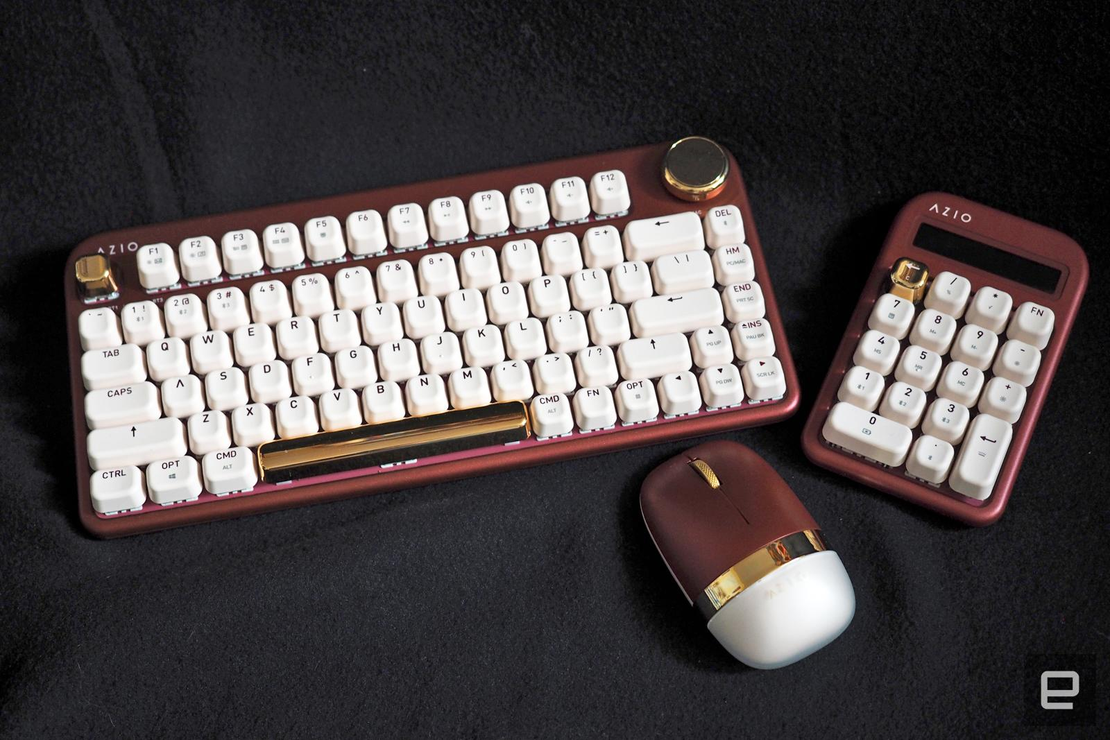 AZIO IZO keyboard and mouse peripherals photographed on a black cloth background.