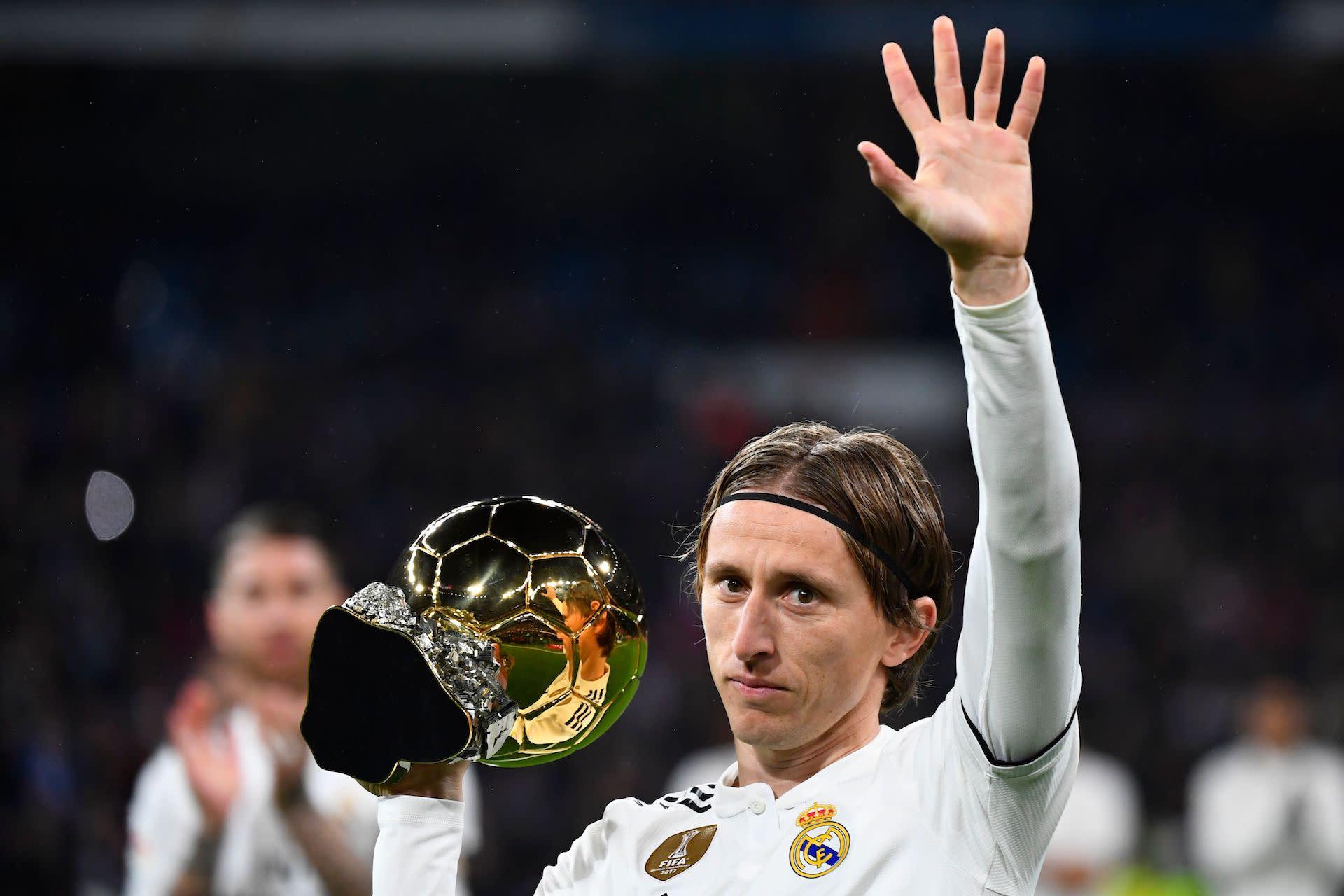 Luka Modric didn't seem happy that Cristiano Ronaldo and Lionel Messi decided to skip the Ballon d'Or ceremony. (Goal.com)