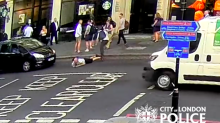 Police search for man who shoved pedestrian into London traffic after they 'brushed shoulders'