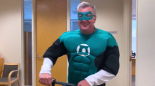 Hurricanes' GM Don Waddell dresses as the Green Lantern for Halloween