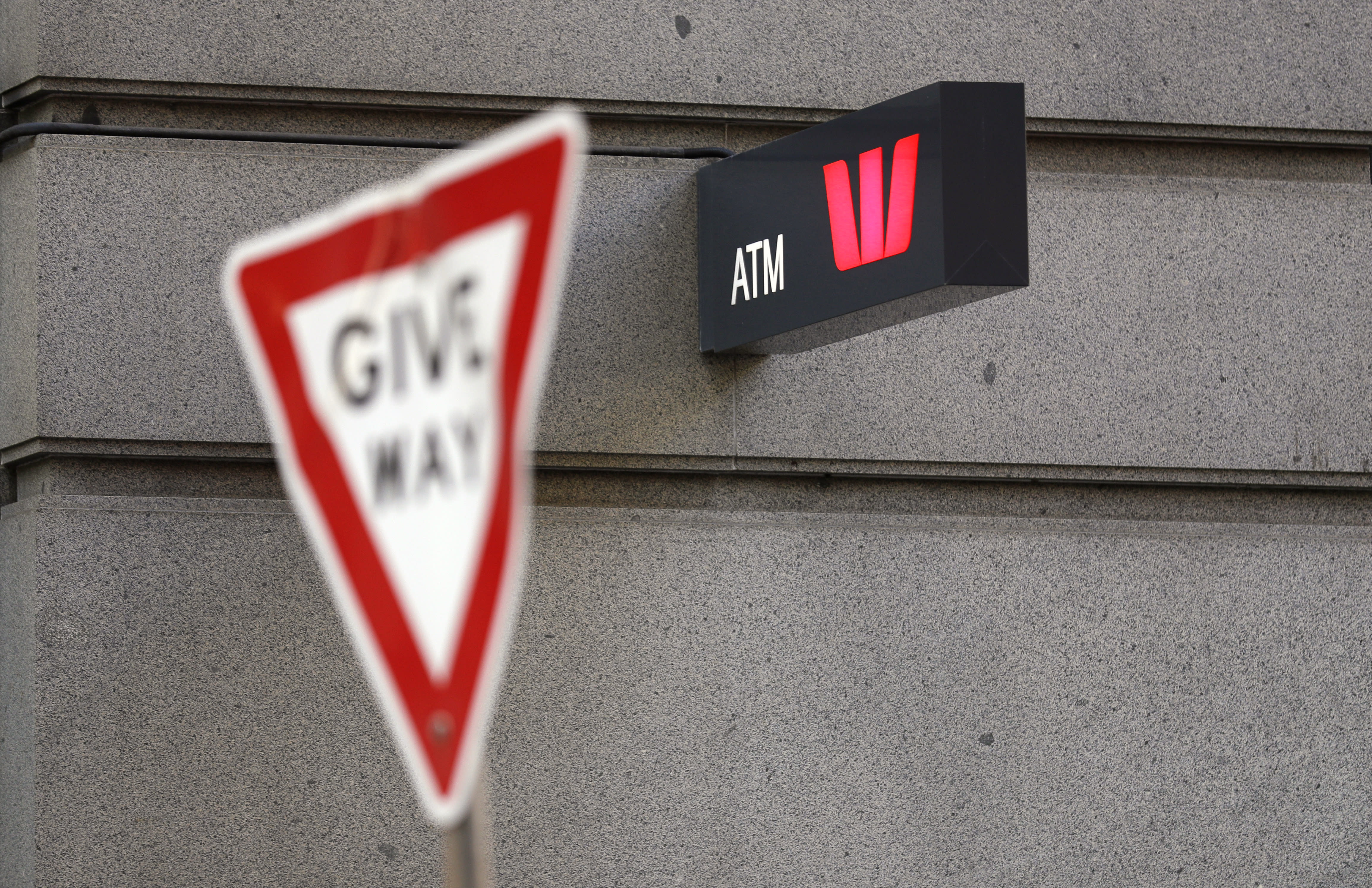 A Westpac bank ATM sign is posted on a wall in Sydney, Thursday, Sept. 24, 2020. Westpac, Australia's second-largest bank, agreed to pay a 1.3 billion Australian dollar ($919 million) fine for breaches of anti-money laundering and counterterrorism financing laws, the largest ever civil penalty in Australia, a financial crime regulator said. (AP Photo/Rick Rycroft)