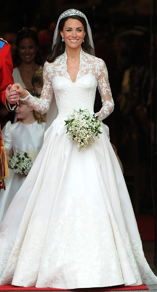 The blushing bride steps out of Westminster Abbey, stunning in her Sarah Burton for Alexander McQueen gown.