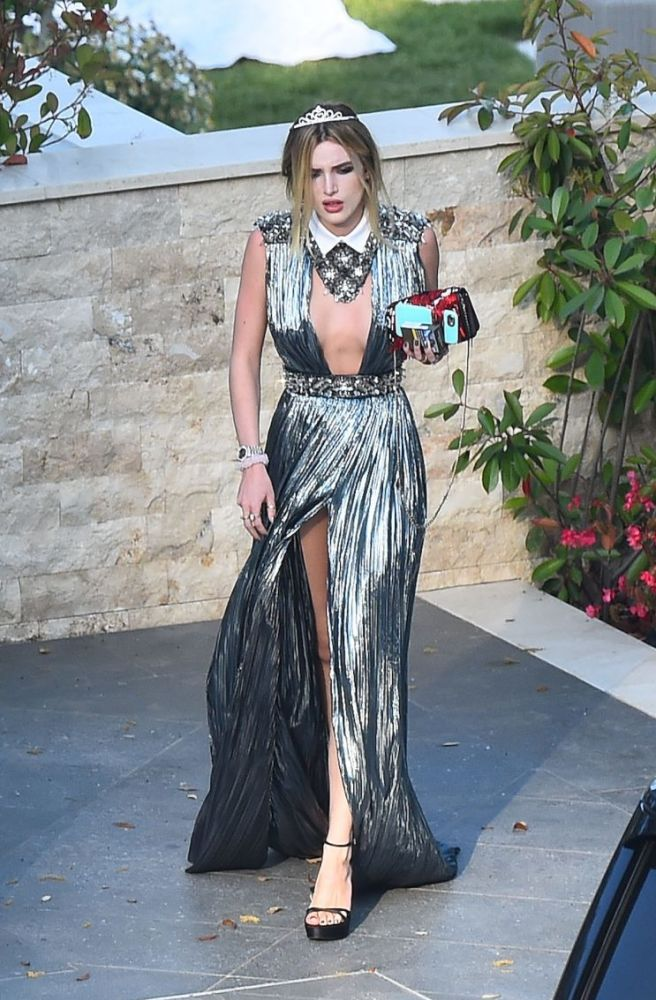 Bella Thorne wears a tiara with her silver gown