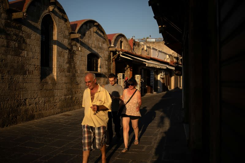 People make their way in the Old Town of Rhodes, following the coronavirus disease (COVID-19) outbreak, on the island of Rhodes