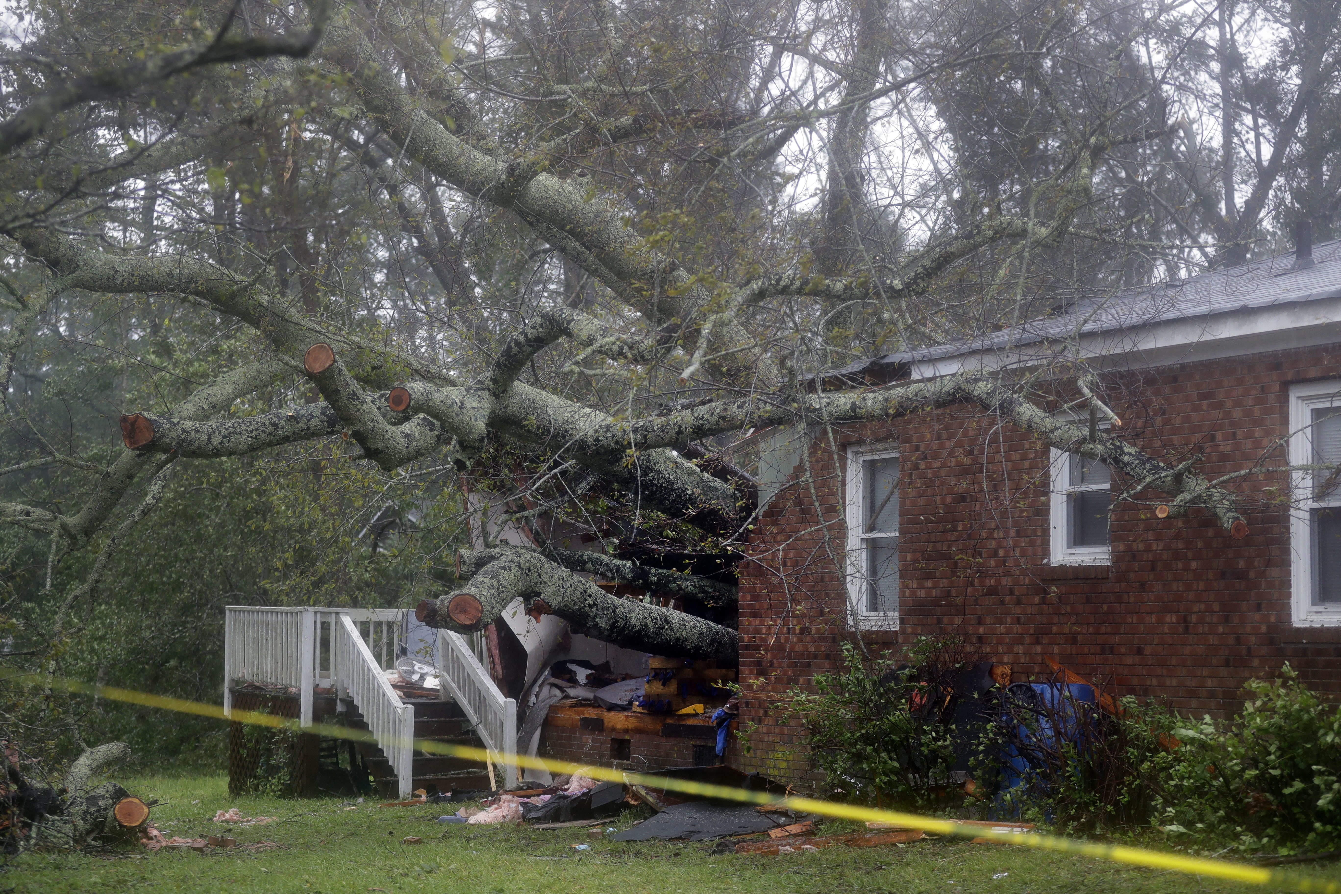 <p>A fallen tree is shown after it crashed through the home where a woman and her baby were killed in Wilmington, N.C., after Hurricane Florence made landfall Friday, Sept. 14, 2018. (Photo: Chuck Burton/AP) </p>
