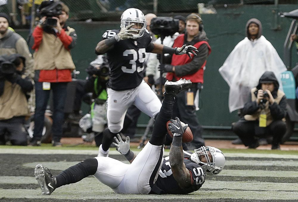 Raiders linebacker NaVorro Bowman made a nifty INT of the Broncos on Sunday. (AP)