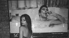 Emily Ratajkowski poses in a steamy snap in a hot-tub