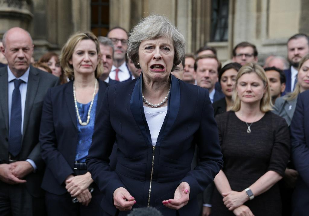 Britain's new Conservative Party leader Theresa May (centre) speaks to reporters outside the Palace of Westminster in London, on July 11, 2016