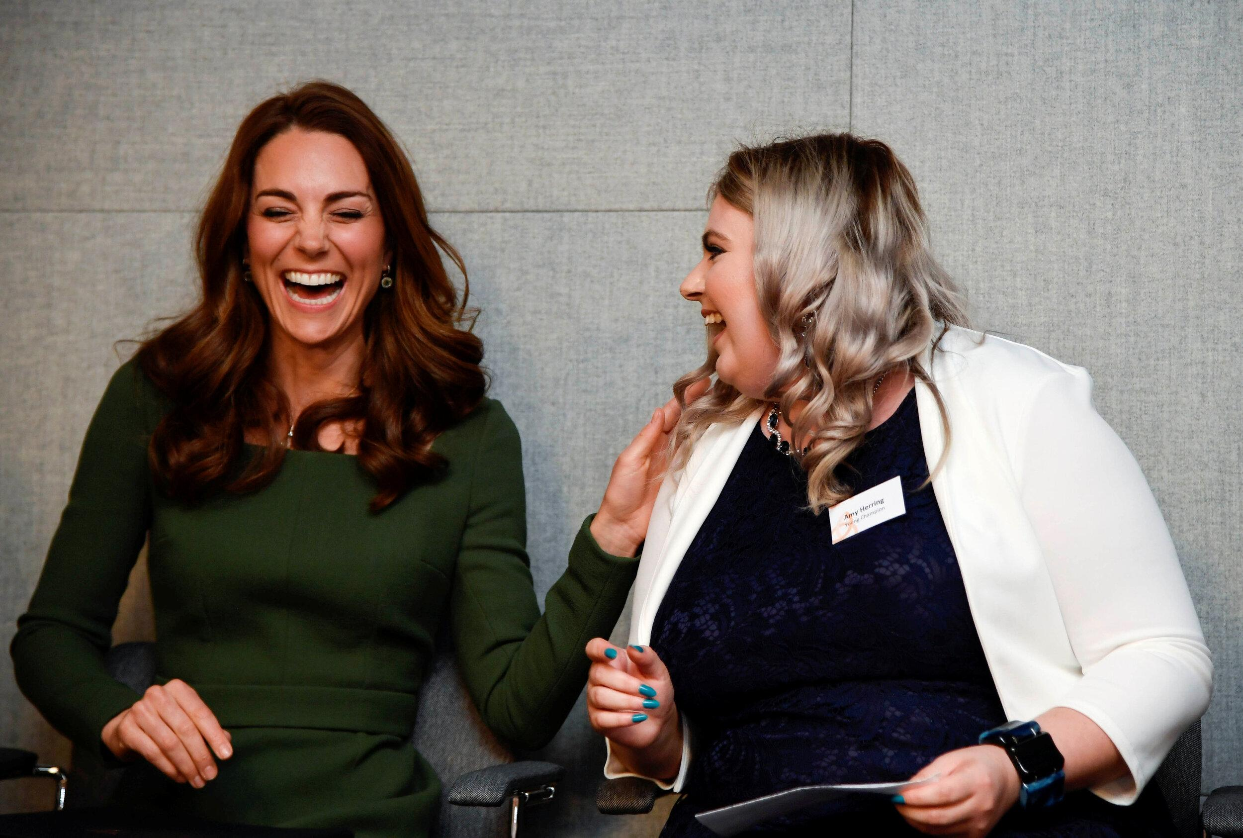Britain's Catherine, Duchess of Cambridge shares a laugh with Amy Herring as she visits the Anna Freud National Centre for Children and Families in London on May 1, 2019. (Photo by TOBY MELVILLE / POOL / AFP)        (Photo credit should read TOBY MELVILLE/AFP/Getty Images)