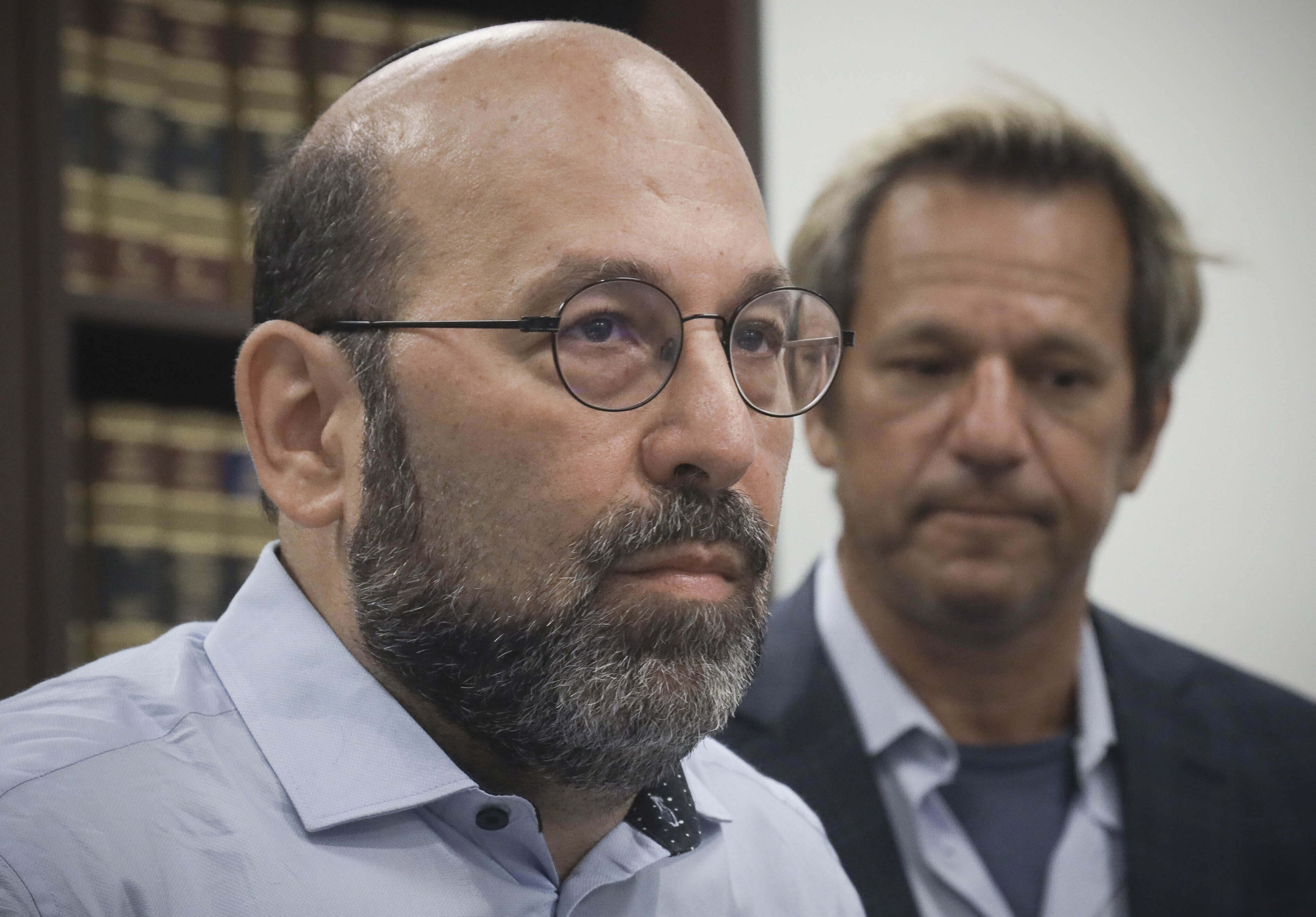 Jay Goldberg, left, and Barry Singer, right, victims who say they were sexually abused while they were students at Marsha Stern Talmudical Academy (MTA)—also known as Yeshiva University High School for Boys in Manhattan, hold a press conference, Thursday Aug. 22, 2019, in New York. They are among 38 former students in a lawsuit alleging sexual abuse by two rabbis: George Finkelstein, a long-time MTA principal, and Macy Gordon, a long-time MTA Judaic Studies teacher. (AP Photo/Bebeto Matthews)