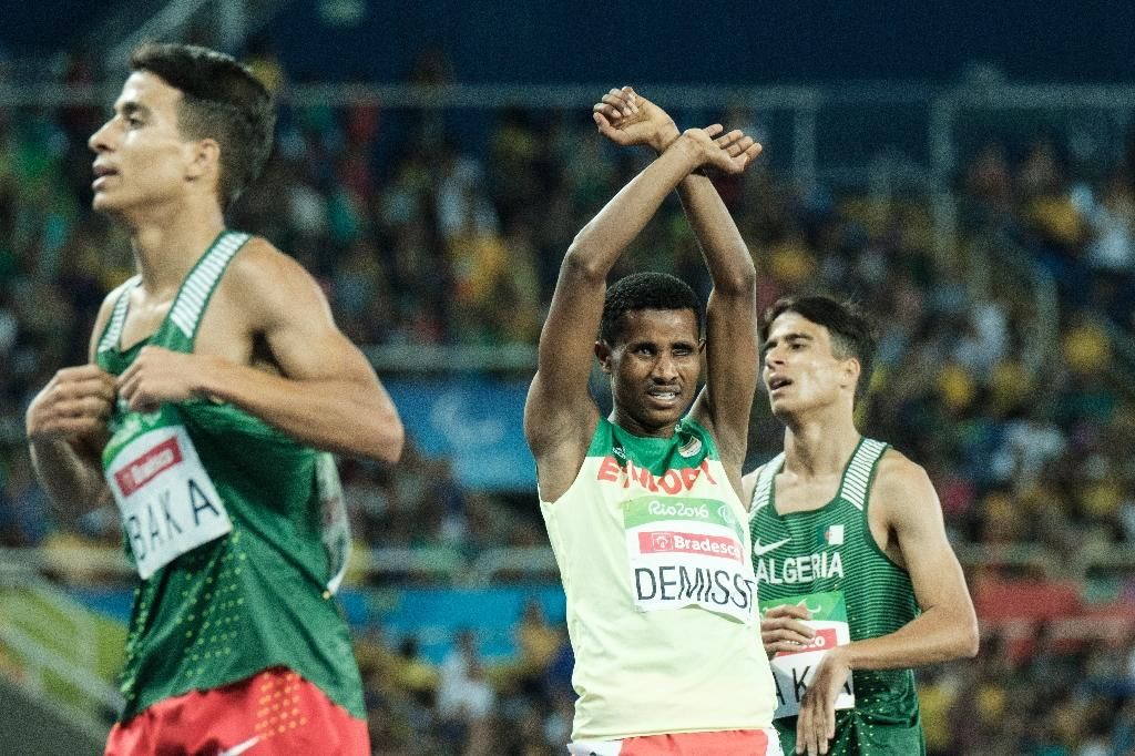 Ethiopia's Tamiru Demisse (C) reacts after the final of men's 1500m of the Rio 2016 Paralympic Games on September 11, 2016