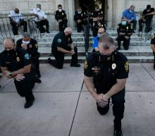 Officers kneel in solidarity with protesters in several cities