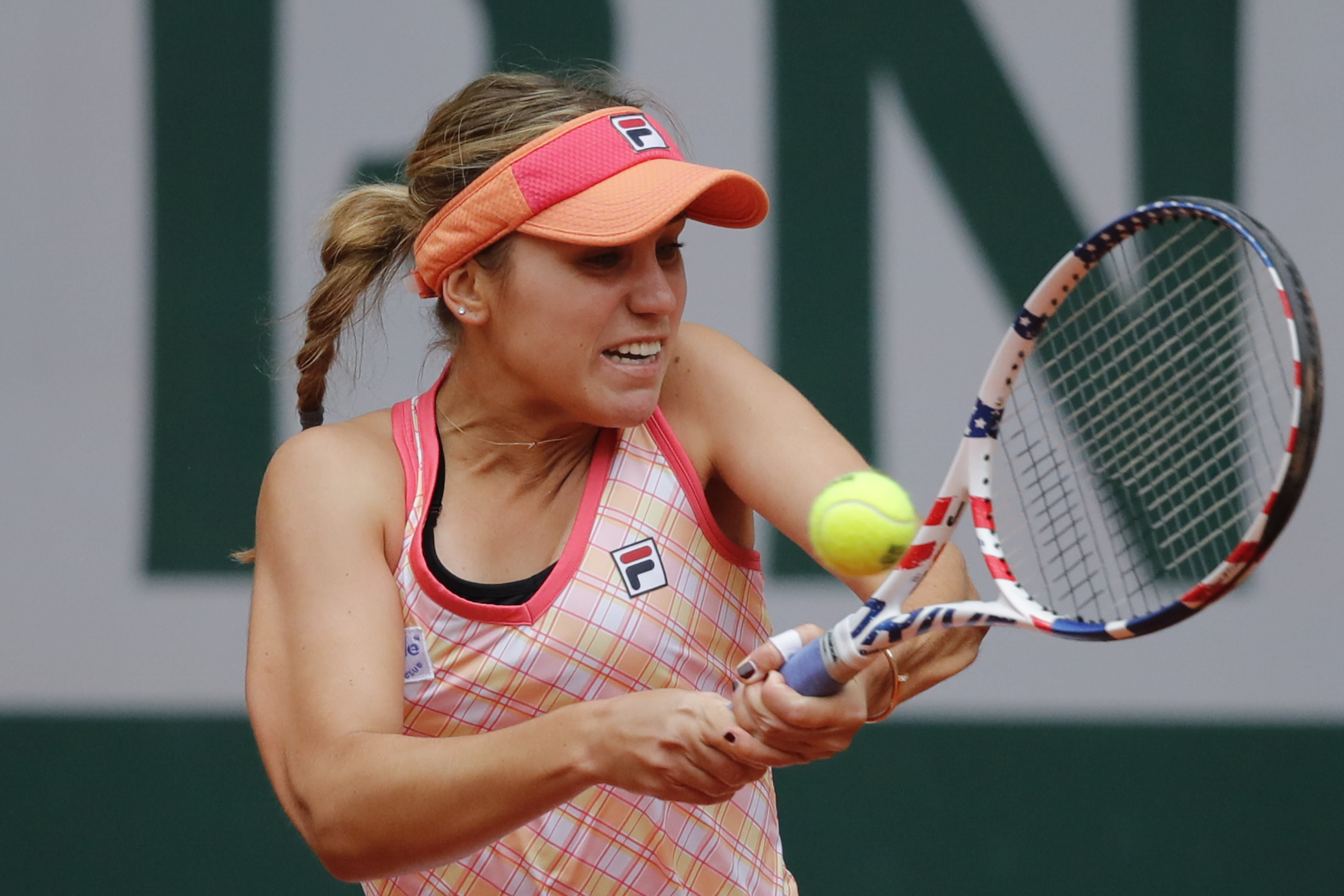 Sofia Kenin of the U.S. plays a shot against Romania's Irina Bara in the third round match of the French Open tennis tournament at the Roland Garros stadium in Paris, France, Saturday, Oct. 3, 2020. (AP Photo/Christophe Ena)