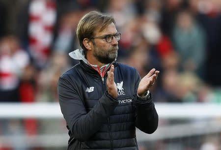 Liverpool manager Juergen Klopp applauds fans after the match