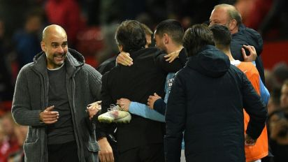 Guardiola urges title calm after Man City beat United