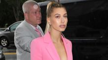 Rainy Weather Doesn't Stop Hailey Baldwin From Rocking a Pink Power Suit