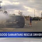 VIDEO: Good Samaritans rescue driver from burning car