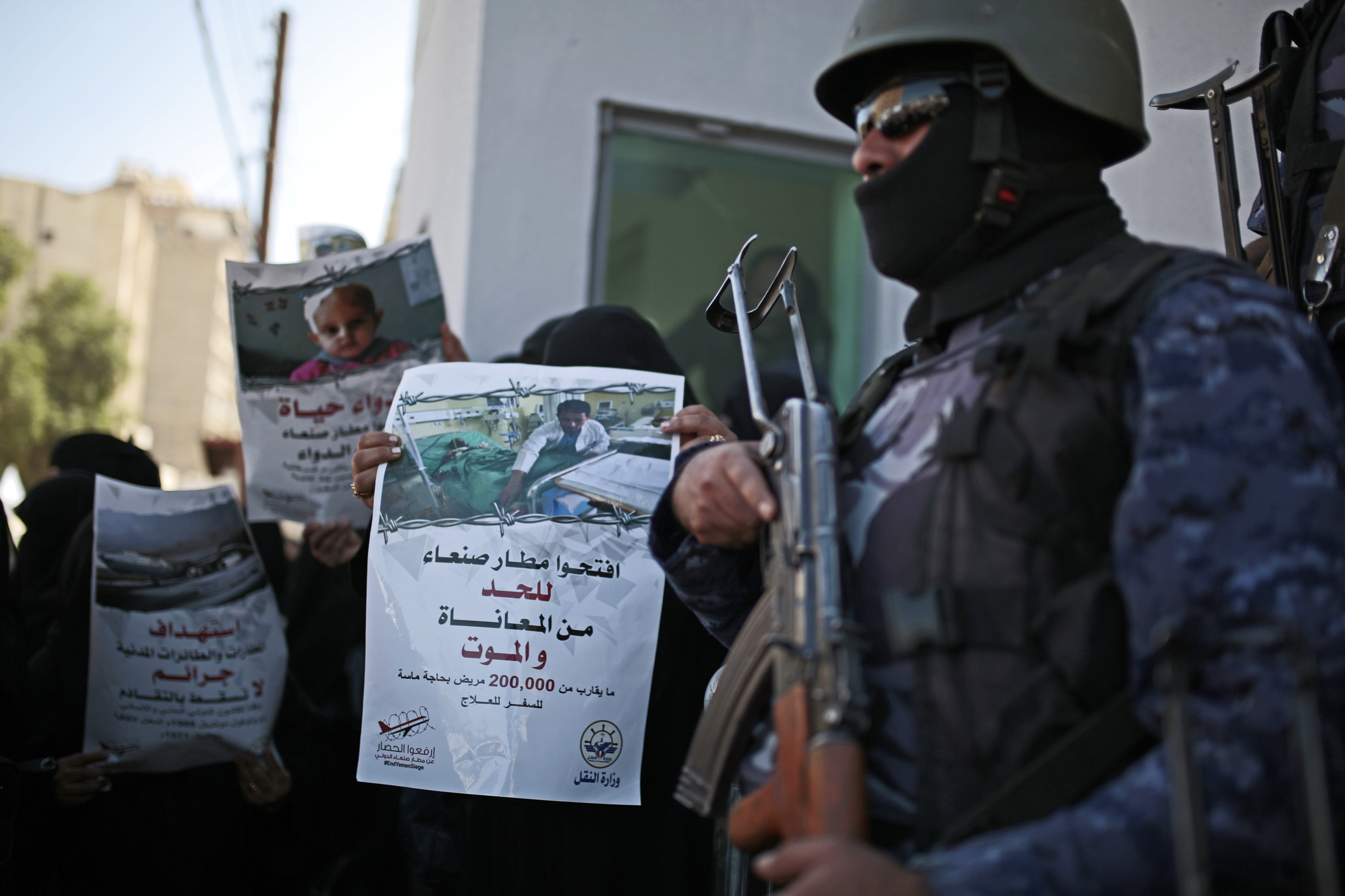 """FILE - In this Dec. 10, 2018 file photo, a Yemeni woman holds a banner with Arabic that reads: """"Open Sanaa airport to limit the suffering and deaths!"""" during a protest calling for the reopening of Sanaa airport to receive medical aid, in front of the U.N. offices in Sanaa, Yemen. The Norwegian Refugee Council and CARE have slammed the Saudi-led coalition for its closure of the airport in Yemen's capital, saying this has prevented thousands of sick civilians from traveling abroad for urgent medical treatment, saying the Sanaa airport's three-year closure has amounted to a """"death sentence"""" for many sick Yemenis. The two aid groups appealed late Monday, Aug 5, 2019 on Yemen's warring parties to come to an agreement to reopen the airport for commercial flights to """"alleviate humanitarian suffering caused by the closure."""" (AP Photo/Hani Mohammed, File)"""