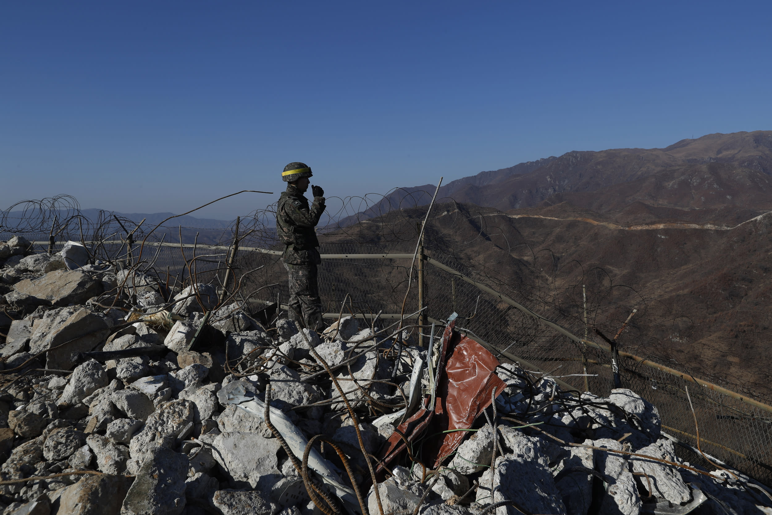 DMZ, SOUTH KOREA - DECEMBER 12: A South Korean army soldier stands guard at the South's dismantled guard post inside the Demilitarized Zone (DMZ) during a mutual on-site verification of the withdrawal of guard posts along the Demilitarized Zone (DMZ) on December 12, 2018 in DMZ, South Korea. The two Koreas have begun to destroy 20 guard posts along the heavily-fortified border between the two nations. The removal of the guard posts was decided during the 19 September Pyongyang summit between South Korean President Moon Jae-in and North Korean leader Kim Jong-un. (Photo by Jeon Heon-Kyun - Pool/Getty Images)
