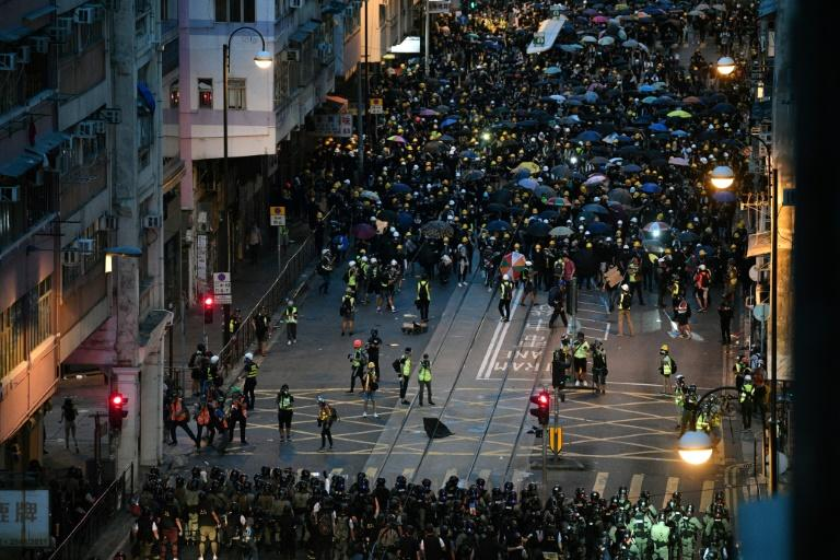 Hong Kong protesters stream past designated endpoint