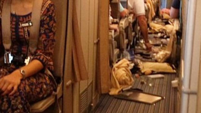 Turbulence or food fight? In-flight meals hit the ceiling