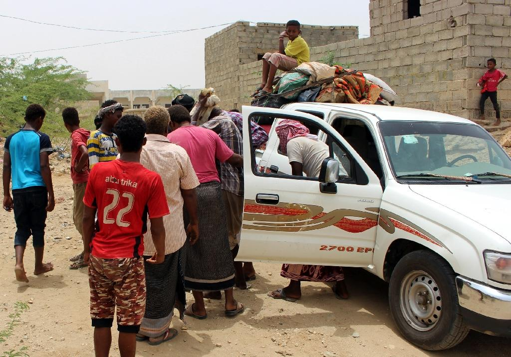 Displaced Yemenis who fled their homes in the war-torn port city of Hodeida arrive at a makeshift camp for the displaced in the northwestern province of Hajjah
