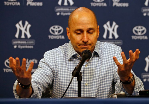 NEW YORK, NY - AUGUST 01: Brian Cashman, general manager of the New York Yankees, talks during a press conference before a game against the New York Mets at Citi Field on August 1, 2016 in the Flushing neighborhood of the Queens borough of New York City. (Photo by Rich Schultz/Getty Images)