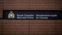 Saskatchewan RCMP officer arrested after man found dead in wooded area