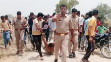 """Was Trying to Lift Qasim From a Pit"": Cop in Viral Pic From Hapur"