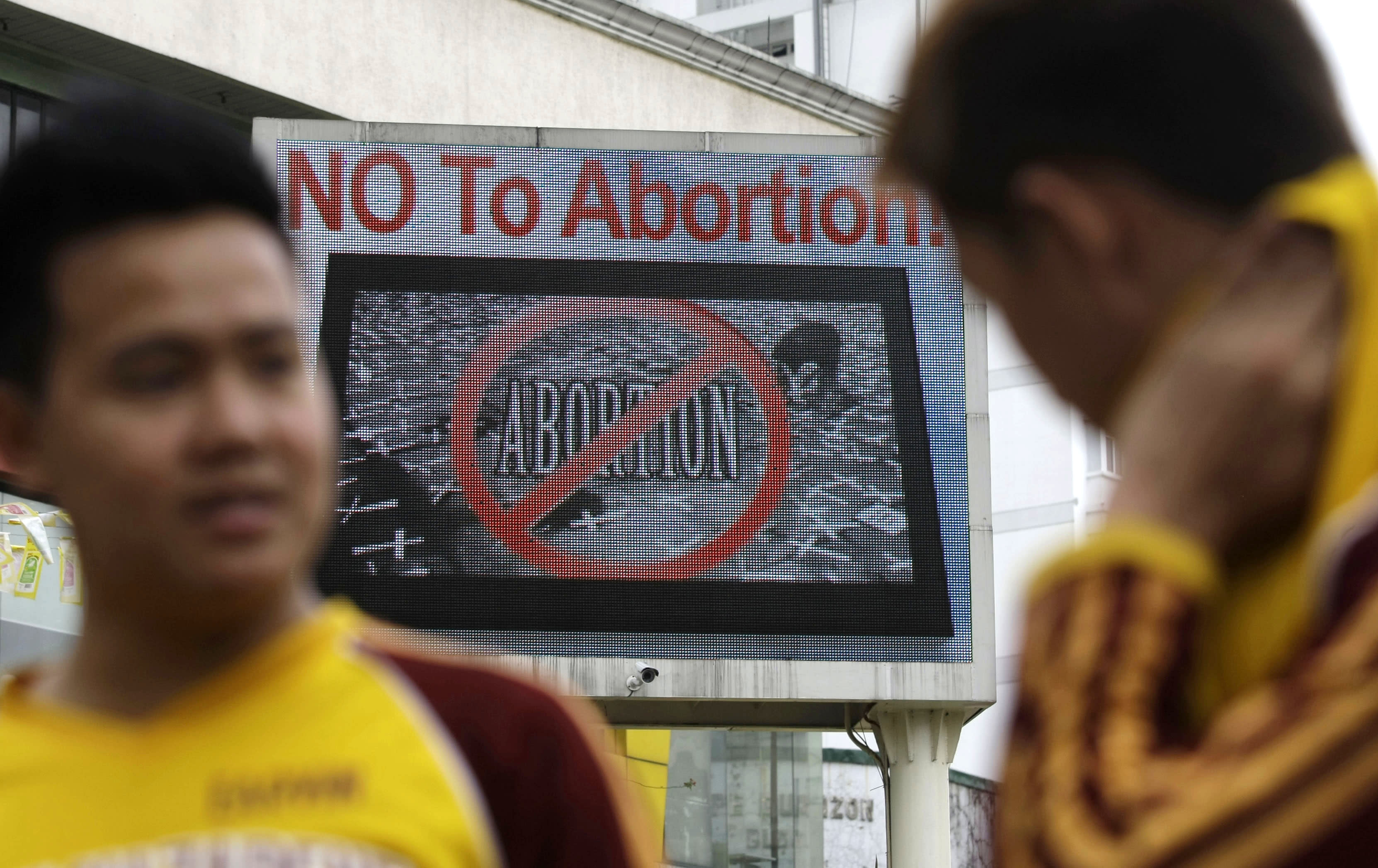 An anti-abortion sign flashes on an electric signboard outside the Roman Catholic Minor Basilica of the Black Nazarene in downtown Manila, Philippines on Thursday, Jan. 3, 2013. Philippine President Benigno Aquino III last month signed the Responsible Parenthood and Reproductive Health Act of 2012. The law that provides state funding for contraceptives for the poor pitted the dominant Roman Catholic Church in an epic battle against the popular Aquino and his followers. (AP Photo/Aaron Favila)