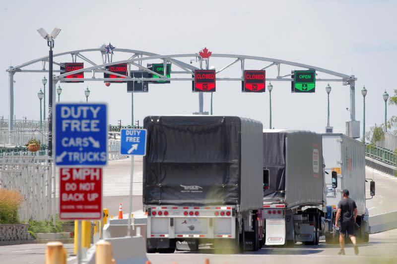 FILE PHOTO: Trucks prepare to cross The Peace Bridge, which runs between Canada and the United States, over the Niagara River in Buffalo, New York