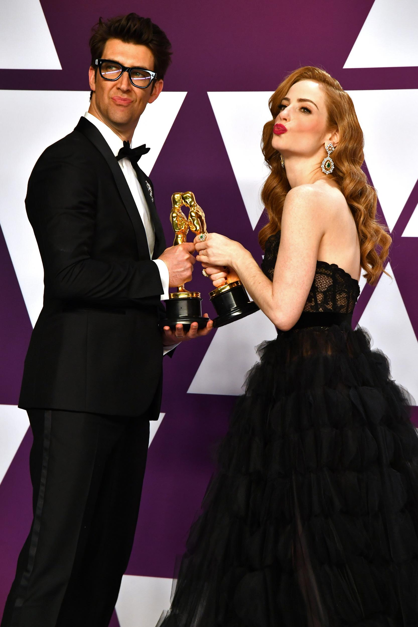 HOLLYWOOD, CA - FEBRUARY 24:  Guy Nattiv (L) and Jaime Ray Newman, winners of Best Live Action Short Film for 'Skin' pose in the press room during at Hollywood and Highland on February 24, 2019 in Hollywood, California.  (Photo by Jeff Kravitz/FilmMagic)