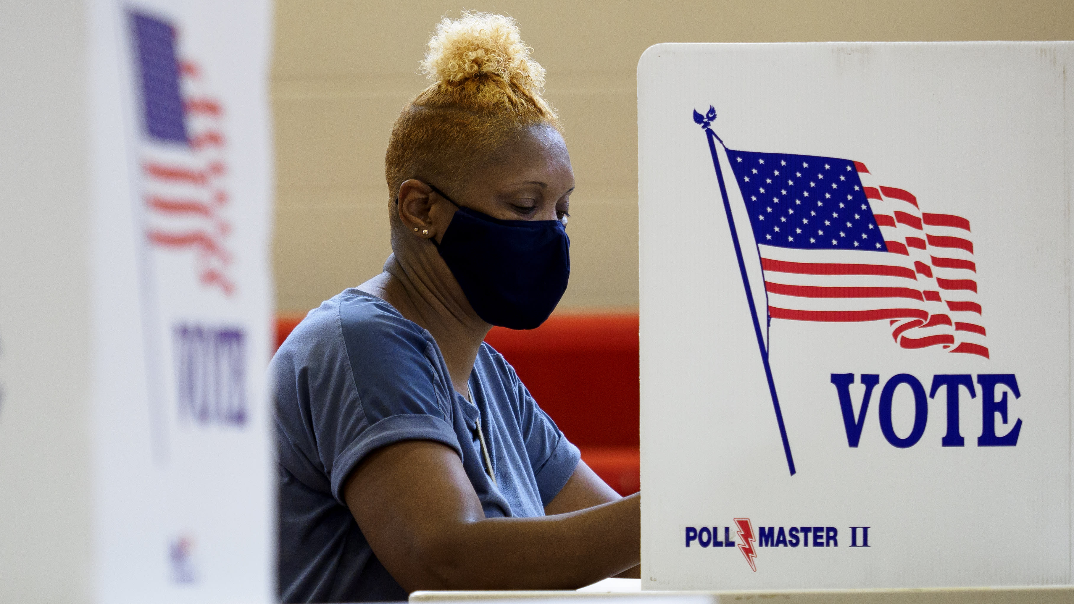 Deborah Thurman votes at the Brainerd Youth and Family Development Center on Saturday, Aug. 1, 2020 in Chattanooga, Tenn. Saturday marked the end of the early voting period. (C.B. Schmelter/Chattanooga Times Free Press via AP)