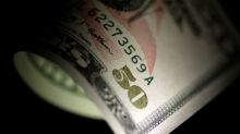 Dollar slips in holiday-thinned trade; loonie, ruble ride oil gains
