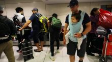 Aussies back home after virus quarantine
