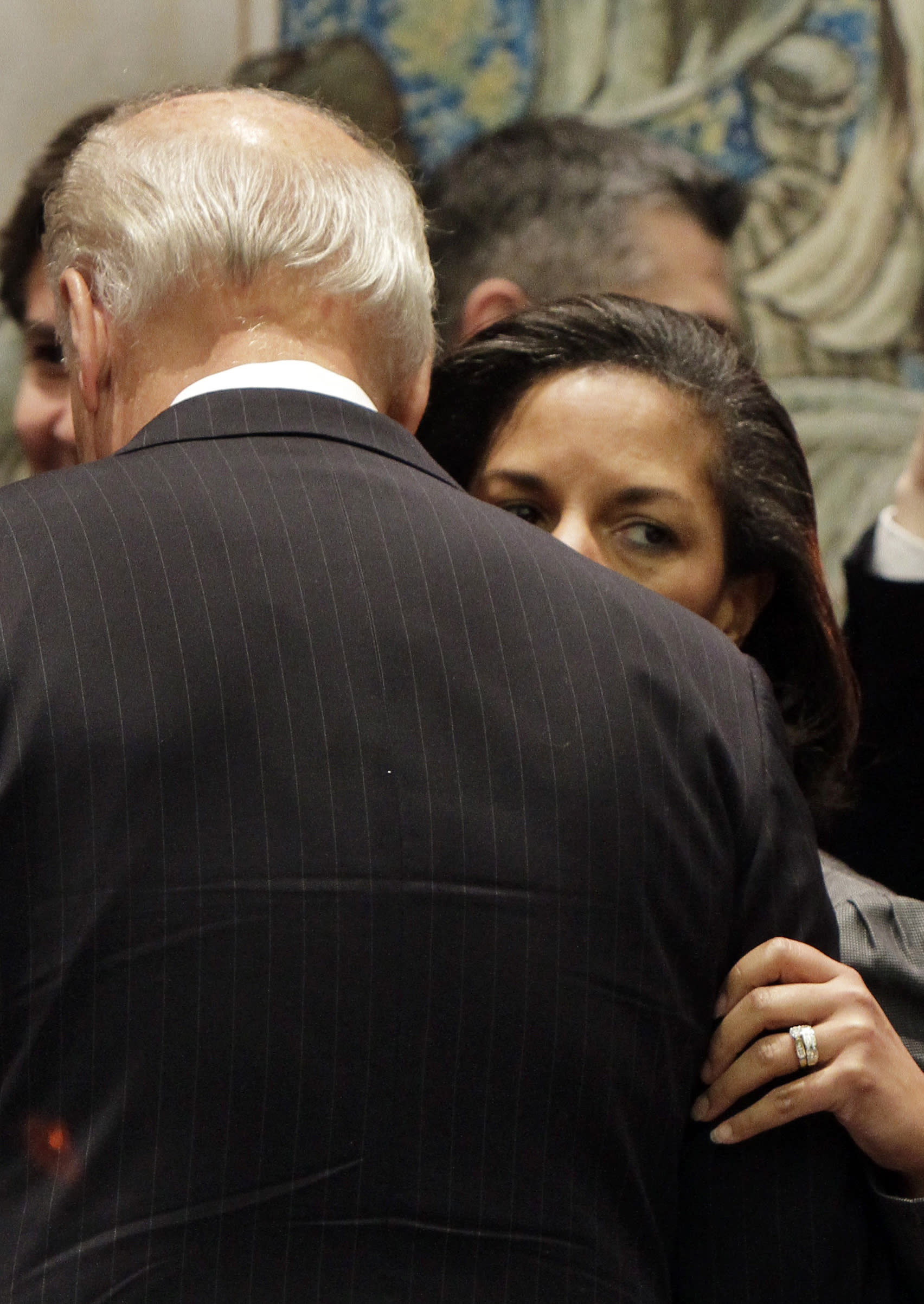 FILE - In this Dec. 15, 2010, file photo Susan Rice, the U.S. ambassador to the United Nations, whispers in the ear of Vice President Joe Biden in the United Nations Security Council, at U.N. headquarters. Democratic presidential nominee Joe Biden is in the final stages of selecting his running mate. Among the contenders is Susan Rice, who worked closely with Biden in the Obama administration and regularly briefed him on pressing foreign policy matters when she served as national security adviser. (AP Photo, File)